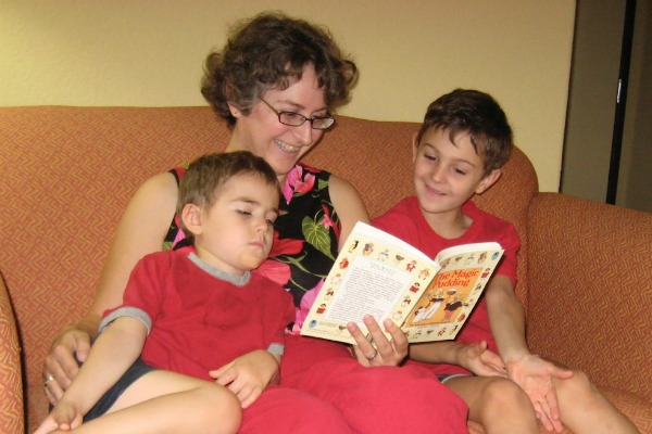 Kathy reading to two boys